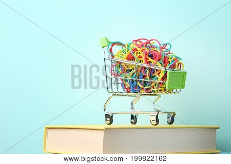 Shopping Cart With Rubber Bands On Mint Background
