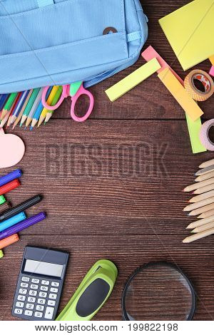 School supplies on the brown wooden table