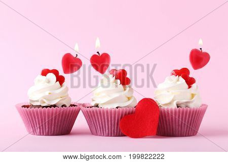 Tasty Cupcakes With Candles On Pink Background