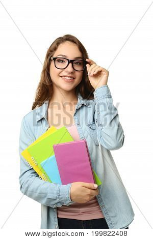 Portrait of student girl with books on white background
