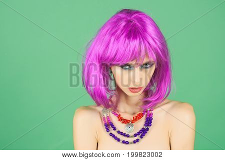 Woman In Violet Wig With Fashionable Makeup.
