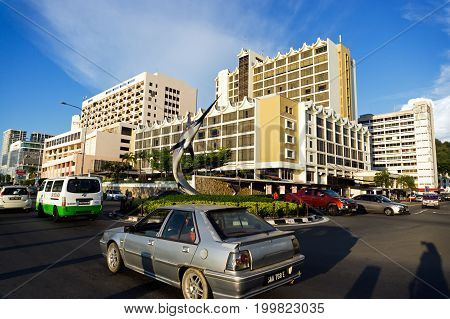 Kota Kinabalu Malaysia - August 01 2017: Traffic at Kota Kinabalu city street in the late afternoon. Kota Kinabalu formerly known as Jesselton is the capital of the state of Sabah Malaysia.