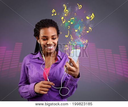 young girl with headphones listening to music on smartphone