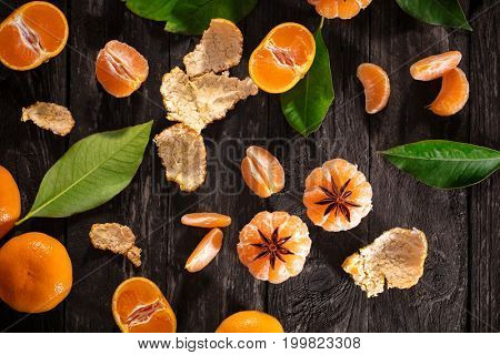 fresh mandarines with anise star on wooden background