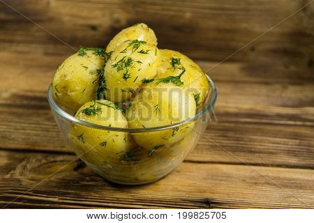 Boiled New Potatoes With Butter And Dill On Wooden Table
