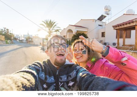 Portrait of a laughing cheerful couple holding keys to their new house. New home owners concept.