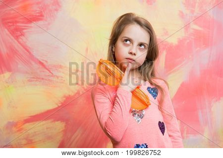 Girl With Thoughtful Face Holding Orange Sunglasses