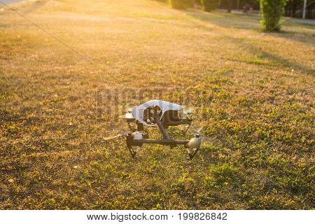 White drone, quadrocopter with photo camera flying in the blue sky