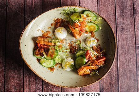 Vegetable Salad With Shrimps On A Plate On A Wooden Background