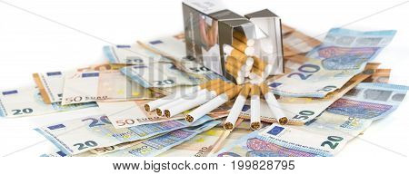 20 and 50 Euro banknotes bills cash with cigarettes with cigarettes box. Concept of cost of tabacco cigarettes. Front and top view close-up. On white background. Panormaic picture
