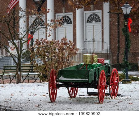 Christmas Antique Wagon in the Village Square with Gifts