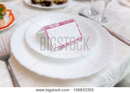 White Place Card Decorated On A Plate