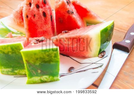 Fresh and juicy watermelon on the plate. Ripe watermelon to the delight of children