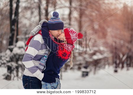 Lovers Man And Woman Kissing In Winter Park At Valentine's Day