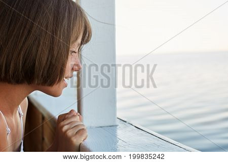 Sea Voyage Concept. Little Girl With Bobbed Hair Having Sea Trip On Ship, Looking From Deck, Watchin