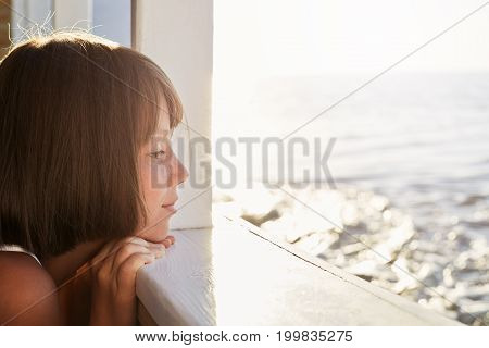 Little Child With Short Dark Hair, Looking Out From Deck Of Ship, Admiring Calm Sea While Resting Du