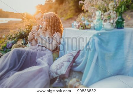 Boho Chic Couple In Love The Bride And Groom. Wedding Inspiration Picnic Outdoors, With The Dinner T