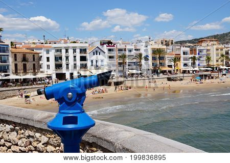 The tourists binocular near the beach Sitges Spain