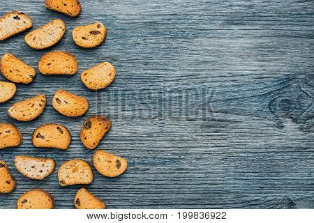Rusk with raisins on a wooden blue background.View from above