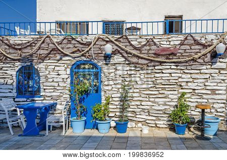 Bodrum Turkey - June 1 2017: A typical mediterranean restaurant with the blue equipment plant pots and fishing decoration which is common in Greece and Turkey.