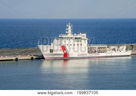 Catania Italy - July 3 2017: Dattilo-class patrol boat - an italian coast guard or coastguard vessel which have responsibility for enforcement of shipping and maritime safety regulations as well as performing search and rescue duties.