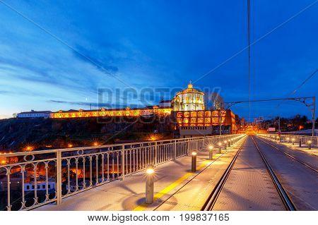 Old metal bridge of Don Luisa across the river Duero in the night illumination. Porto. Portugal.