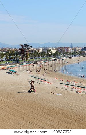 SALOU SPAIN - MAY 25: The tourists enjoiying their vacation on the beach on May 25 2015 in Salou Spain. Up to 60 mln tourists is expected to visit Spain in year 2015.