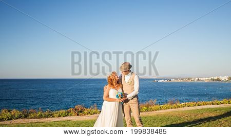 Just married couple embraced on nature. Bride and groom.