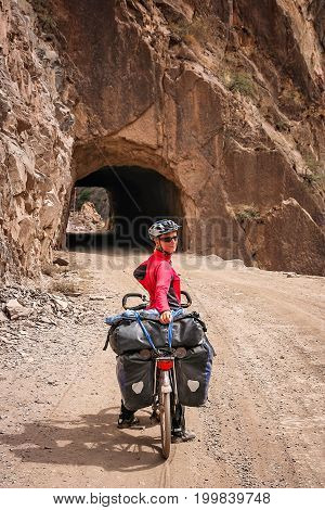Woman posing for a picture while on a cycle touring trip in Yunnan Province, China