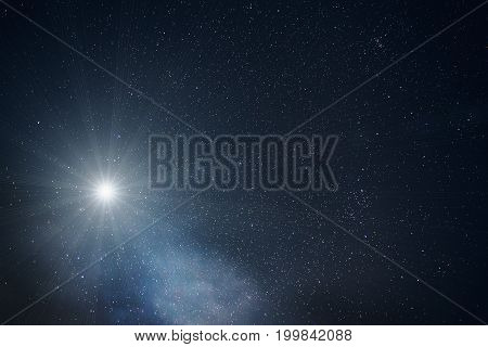 One bright big star in night sky with lots of stars, toned