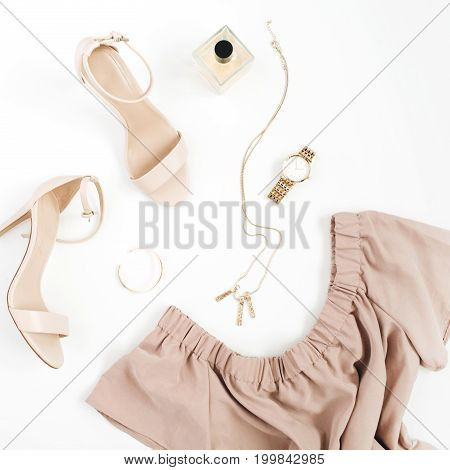 Woman trendy fashion clothes and accessories collage on white background. Flat lay top view.
