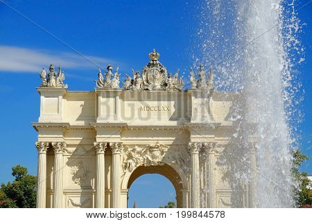 POTSDAM GERMANY - AUGUST 15 2017: View on the Brandenburg Gate and fountain in Potsdam.