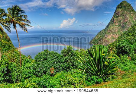 Rainbow rises over the waters in the bay of Piton in Saint Lucia