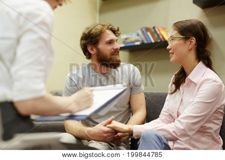 Young couple reconciled after psychological analysis