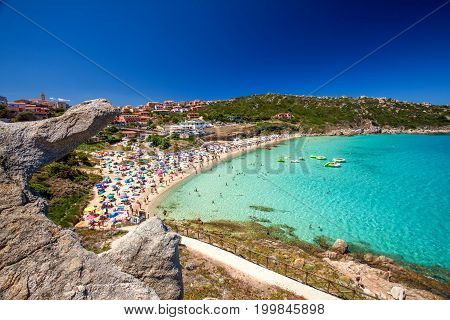 Spiaggia Di Rena Bianca Beach With Red Rocks And Azure Clear Water,