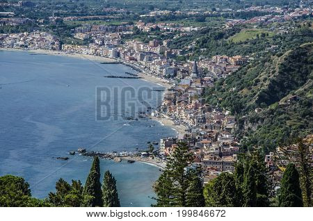 Panoramic view of the Mediterranean sea bathing the beaches of a city and irregularities of the Sicilian territory