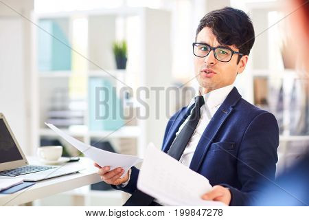 Confident entrepreneur explaining terms of contract to business partner