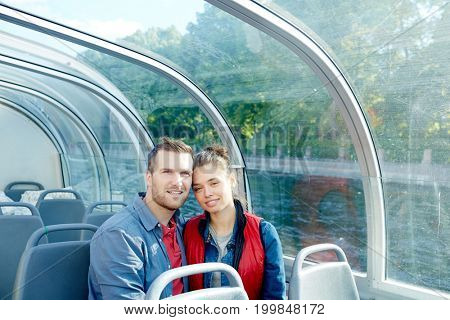 Couple of young amorous passengers sitting inside steamer