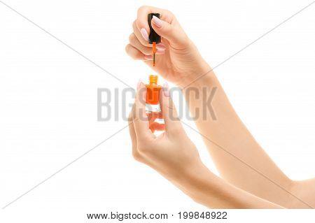 Nail polish in female hands gel varnish on white background isolation