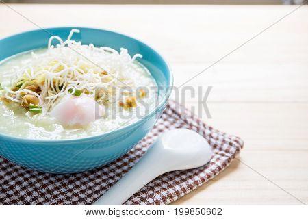 Thai Rice Porridge With Pork And Spoon On Wood Table,pork Congee