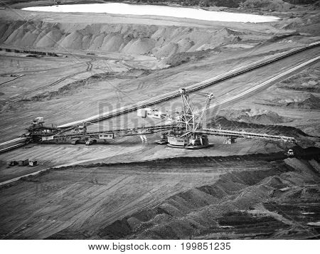 Giant conveyor in surface coal mine, Northern Bohemia, Czech Republic. . Black and white image.