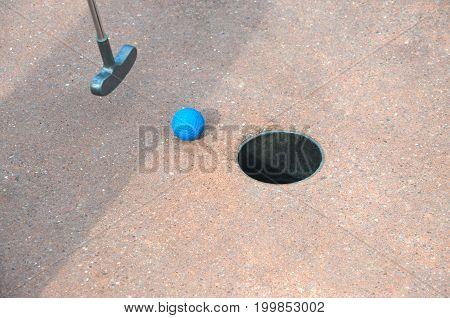 Mini Golf on the hole close up