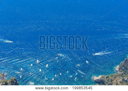 Tyrrhenian Sea waters glimming with sunlight, aerial view , Capri island, Italy