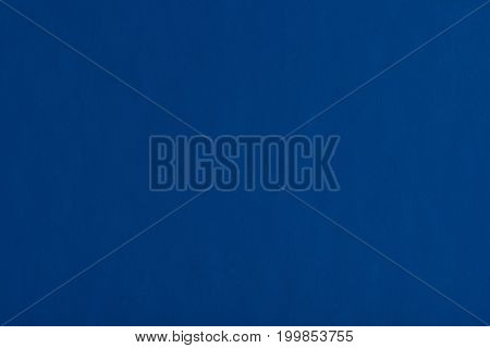 Blue glossy paper background. Empty blue paper texture