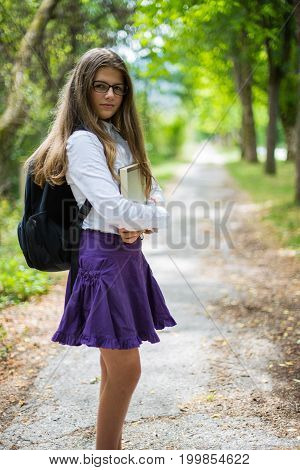 Pretty Beautiful Blonde Child Schoolgirl Posing And Enjoying Life Coming Back To School Through Alle