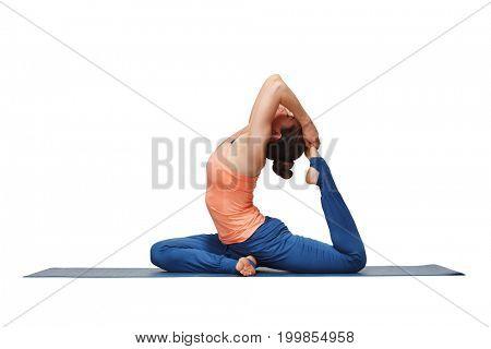 Woman doing Hatha yoga asana Eka pada rajakapotasana - one-legged king pigeon pose isolated
