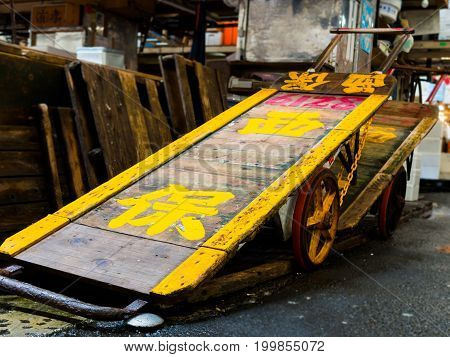 TOKYO, JAPAN JUNE 28 - 2017: Old rusted Flatbed Cart inside of a building of the Tsukiji Wholesale Seafood and Fish Market in Tokyo Japan.