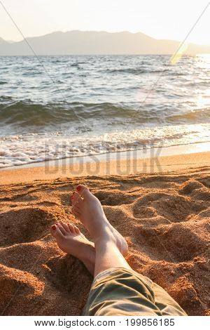 Closeup of Womans Legs and Feet Woman Relaxing at the Beach