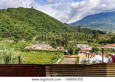 San Cristobal el Bajo, Guatemala - July 10 2017: View from San Cristobal el Cerrito of Agua volcano & San Cristobal el Bajo outside the UNESCO World Heritage Site of Antigua