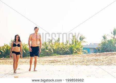tourists walking on jumeirah beach in dubai.